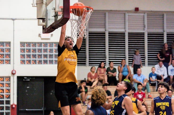 6-foot-9 center Matt Fegurgur slams one home for the Father Duenas Friars in a game against the Guam High Panthers during the GSPN 2020 Preseason Basketball Tournament Jan. 6 at FD's Jungle gym.