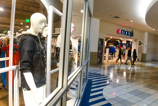 Shoppers depart from the Macy's men's, children's and home section at the Micronesia Mall in Dededo on Jan. 8, 2020.