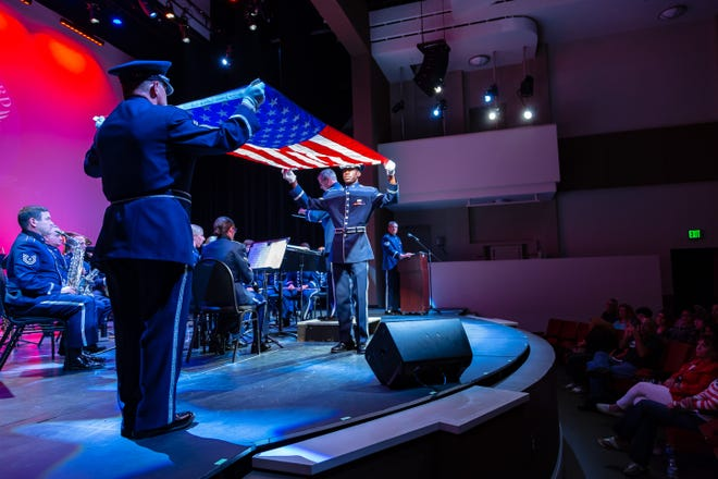 Senior Master Sergeant Steve Burdick and Staff Sergeant Tony Watson begin a flag folding ceremony during a 2018 performance by the ANG Band of the South's Concert Band.