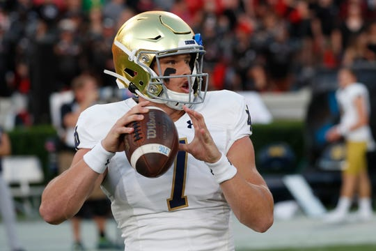 Notre Dame quarterback Brendon Clark (7) warms up before the first half of an NCAA college football game between Georgia and Notre Dame, Saturday, Sept. 21, 2019, in Athens, Ga.