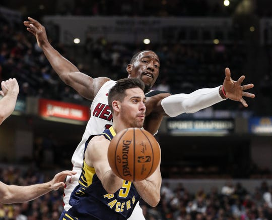 Indiana Pacers guard T.J. McConnell (9) passes the ball against Miami Heat center Bam Adebayo (13) at Bankers Life Fieldhouse, Indianapolis, Wednesday, Jan. 8, 2020.