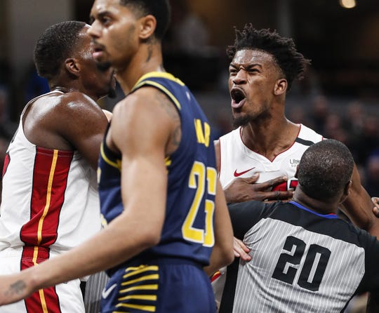 Miami Heat forward Jimmy Butler (22) and Indiana Pacers forward T.J. Warren (1) break out into an argument after a play during the second half at Bankers Life Fieldhouse, Indianapolis, Wednesday, Jan. 8, 2020. Miami Heat defeated the Indiana Pacers, 122-108. Both Warren and Butler were given technical fouls.