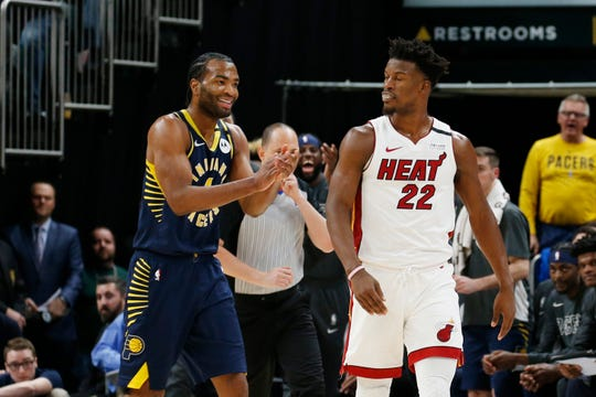 After Miami's Jimmy Butler (22) is called for an offensive foul, Pacers forward T.J. Warren (1) reacts by clapping back, which resulted in a second technical foul and ejection during Wednesday's game at Bankers Life Fieldhouse.