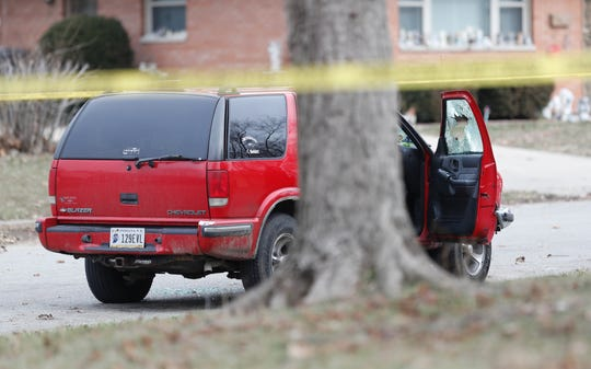 IMPD investigators are on the scene of a double homicide in the 4500 blocks of N. Irwin Ave.  in Indianapolis, Thursday, Jan. 9, 2020. A red SUV containing the victims was blocked off by crime scene tape.