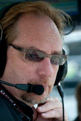In this 2011 file photo, team owner Dennis Reinbold watches Indianapolis 500 practice.