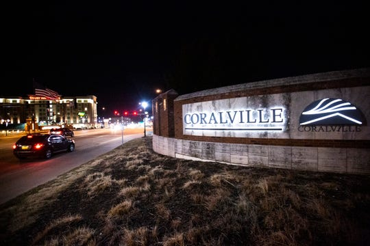A sign welcomes drivers to Coralville off of the Interstate 80 exit along First Avenue, Wednesday, Jan. 8, 2020, in Coralville, Iowa.