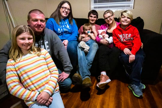 Cydney Benac, second from right, poses for a family photo with her newborn daughter Elizabeth, Wednesday, Jan. 8, 2020, in Muscatine, Iowa.