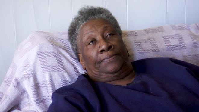 In this image made from Jan. 7, 2020, video, Jeffrie Holliman, mother of slain inmate Roosevelt Holliman, speaks during an interview in Hattiesburg, Miss. Jeffrie Holliman and two other mothers across Mississippi are planning funerals, wondering how and why sons convicted on those charges were killed in state prison.