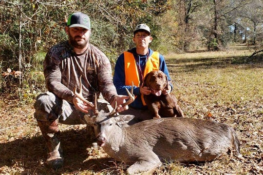 Wayne Atwood of Laurel, left, is just one of the hundreds of hunters who have had deer recovered by Heath Walters, right, and his dog, Gage.