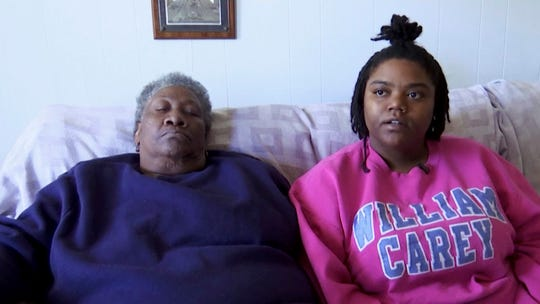In this image made from Jan. 7, 2020, video, Theresa Holliman, a sister of slain inmate Roosevelt Holliman, with her mother Jeffrie Holliman, speaks during an interview in Hattiesburg, Miss. Jeffrie Holliman and two other mothers across Mississippi are planning funerals, wondering how and why sons convicted on those charges were killed in state prison.