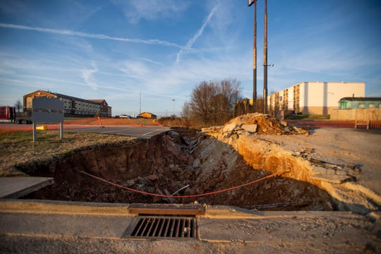 The sinkhole is currently under construction after the roadway caved in near the Old Country Store and the Casey Jones Village in Jackson, Tenn., Jan. 6, 2020.