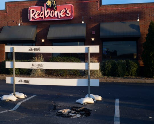 The Redbone's parking lot is blocking off the section where the sinkhole is in Jackson Tenn., Jan. 8, 2020.