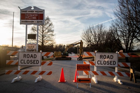 Detour sign directs drivers to enter the Casey Jones Village, and block off the road to start construction of the sinkhole.