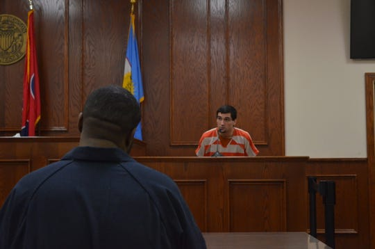Justin Graves, left, watches as Branden Baker testifies that Graves was the driver in a crash that killed a Jackson woman in November during Graves' preliminary hearing in Jackson City Court on Jan. 9.