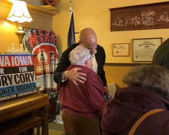 "2.	Sen. Cory Booker, a New Jersey Democrat running for president, hugs an Iowan who came to hear him speak in Creston, Iowa on Jan. 1. Lesser-known candidates have been known to use ""quirks"" to help them stand out ahead of the Iowa Caucus."