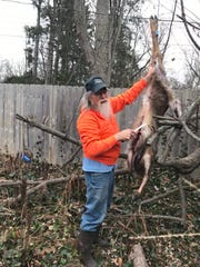 Sportsman Bob Gwizdz skins a doe at home in East Lansing, Jan. 5, 2020.