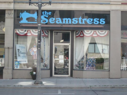 Storefront of The Seamstress in downtown Manitowoc.