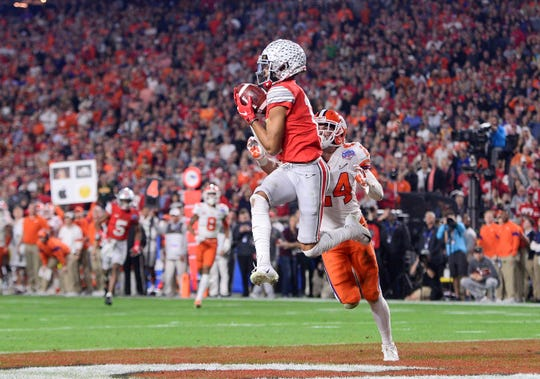 Ohio State's Chris Olave, catching a touchdown pass against Clemson in the playoffs, will lead what should be another productive crew of receivers in 2020.