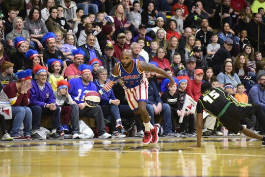 Dizzy of the Harlem Gloebtrotters makes a Washington Generals defender fall to the ground during Wednesday's game.