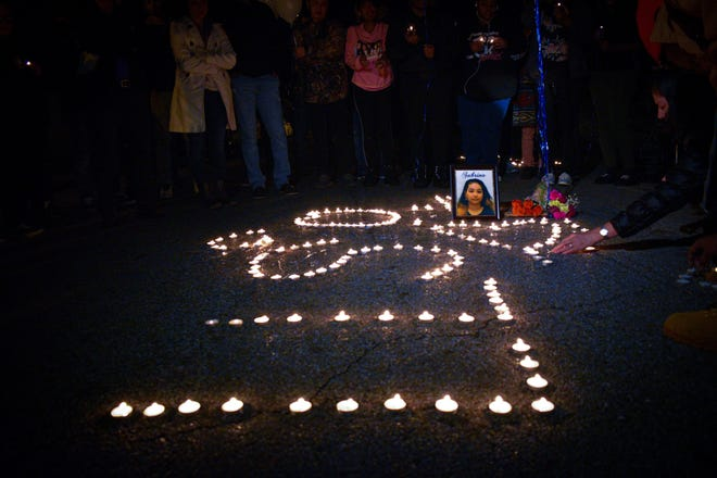 Family and friends gathered at a candlelight vigil for Sabrina Nguyen on Jan. 5. Nguyen was killed in one of the first homicides in 2020.