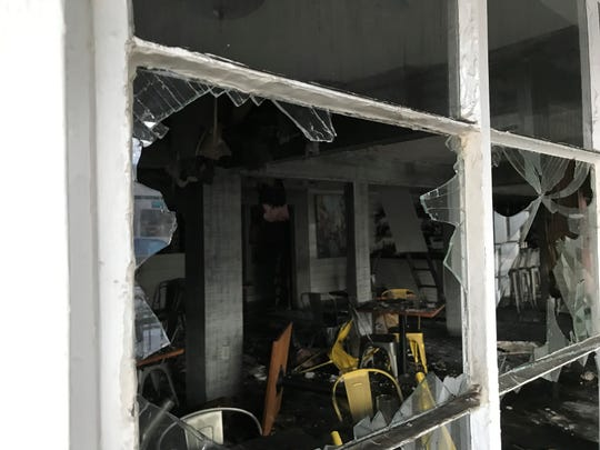 Looking inside Hog & Hominy from the entry window after the fire Thursday, Jan. 9, 2020.