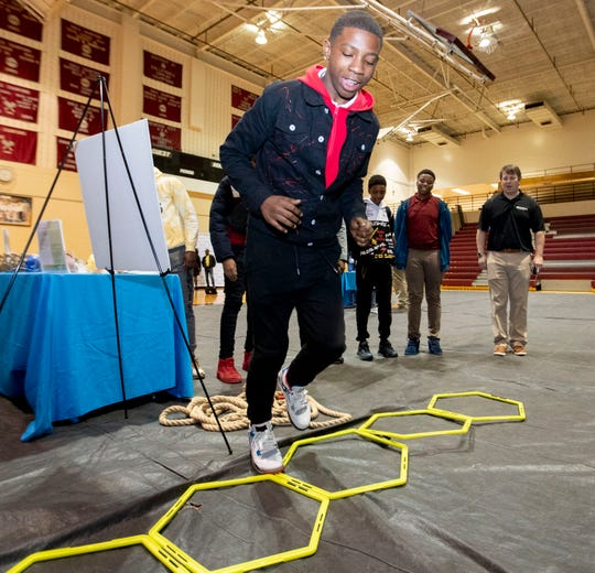 Jakavian Burks, 15, runs through an agility obstacle Thursday, Jan. 9, 2020, at the launch of a healthy living campaign at Craigmont High School in Memphis.