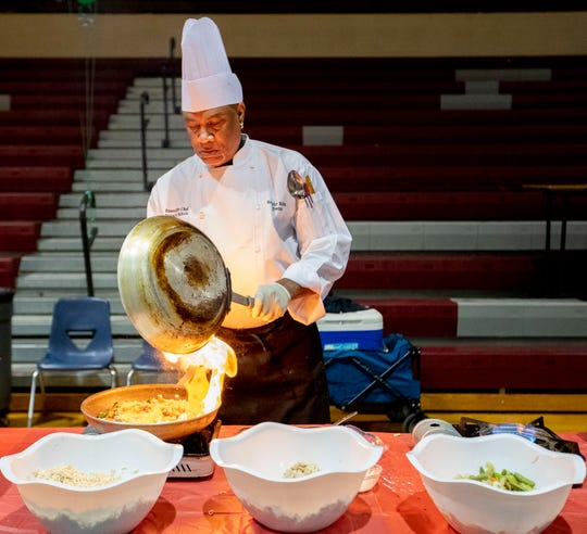Donald Nichols, executive chef with Healthy Kids & Teens, prepares a ramen noodle stir-fry Thursday, Jan. 9, 2020, at the launch of a healthy living campaign at Craigmont High School in Memphis.
