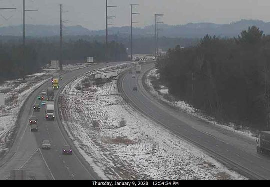A jack-knifed tractor trailer is shown in the median of I-94 near Black River Falls.