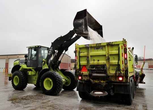 A Milwaukee County snowplow is loaded with salt to spread on roads.