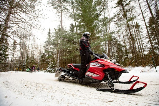 Wisconsin has miles of trails for snowmobiling across serene landscapes.