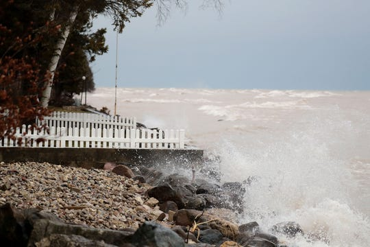 Waves from Lake Michigan wash over boulders in the backyard of a home along the Lake Michigan shore near the Village of Belgium in Ozaukee County in January.