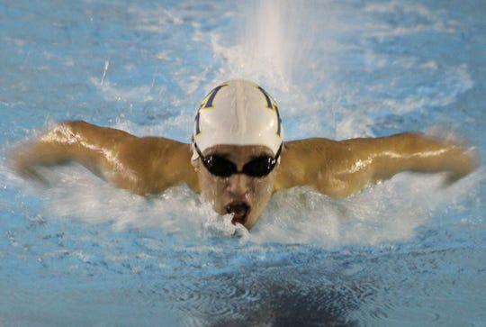 Mountain Home's Noah Daugherty swims a butterfly event on Tuesday at Pocahontas.