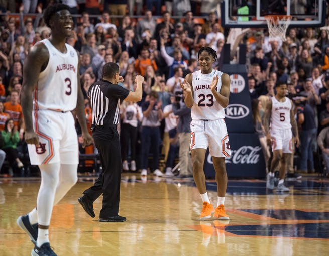 Auburn forward Danjel Purifoy (3) and Auburn forward Isaac Okoro (23) celebrate toward the end of the game at Auburn Arena in Auburn, Ala., on Wednesday, Jan. 8, 2020. Auburn defeated Vanderbilt 83-79.