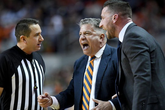 Auburn coach Bruce Pearl and assistant coach Steven Pearl, right, question a call during the first half of the team's NCAA college basketball game against Vanderbilt on Wednesday, Jan. 8, 2020, in Auburn, Ala. (AP Photo/Julie Bennett)
