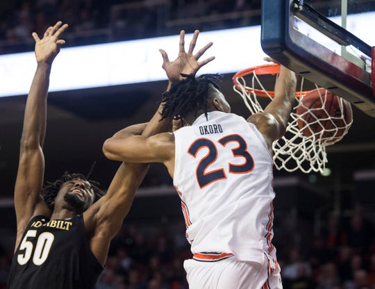 Auburn forward Isaac Okoro (23) dunks over Vanderbilt forward Ejike Obinna (50) at Auburn Arena in Auburn, Ala., on Wednesday, Jan. 8, 2020. Auburn defeated Vanderbilt 83-79.