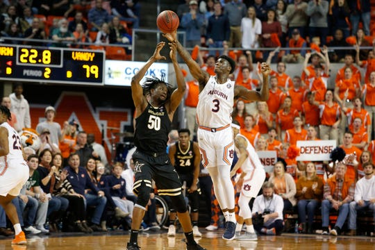 Auburn forward Danjel Purifoy (3) breaks up a pass intended for Vanderbilt forward Ejike Obinna (50) late in the second half at Auburn Arena on Jan. 8, 2020.