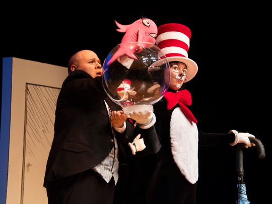 John Cencio Burgos as the fish and Vivienne Claire Luthin as the Cat in the Hat in a scene from Alabama Shakespeare Festival's presentation of Dr. Seuss's The Cat in the Hat, which runs Saturday from January 11–25, 2020.