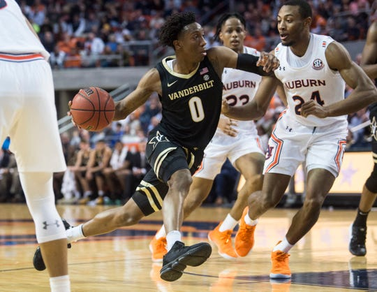 Vanderbilt guard Saben Lee (0) drives to the basket on Auburn forward Anfernee McLemore (24) at Auburn Arena in Auburn, Ala., on Wednesday, Jan. 8, 2020. Auburn leads Vanderbilt 42-38 at halftime.