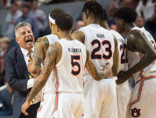 Auburn head coach Bruce Pearl talks with his team as they head out of a timeout at Auburn Arena in Auburn, Ala., on Wednesday, Jan. 8, 2020. Auburn defeated Vanderbilt 83-79.