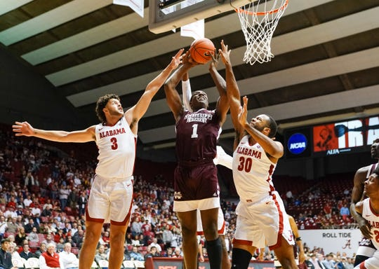 Jan 8, 2020; Tuscaloosa, Alabama, USA; Mississippi State Bulldogs forward Reggie Perry (1) goes to the basket against Alabama Crimson Tide forward Alex Reese (3) and  forward Galin Smith (30) at Coleman Coliseum. Mandatory Credit: Marvin Gentry-USA TODAY Sports