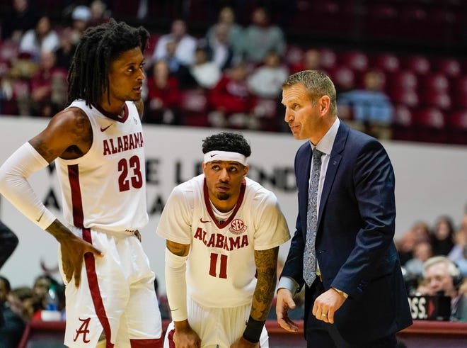 Jan 8, 2020; Tuscaloosa, Alabama, USA; Alabama Crimson Tide head coach Nate Oats talks to guard John Petty Jr. (23) and guard James Bolden (11) during the game against Mississippi State Bulldogs at Coleman Coliseum. Mandatory Credit: Marvin Gentry-USA TODAY Sports
