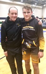 Jacob Clevenger with Coach Darryl Casey after his 8th place finish at Father Ryan on Jan. 4, 2020.