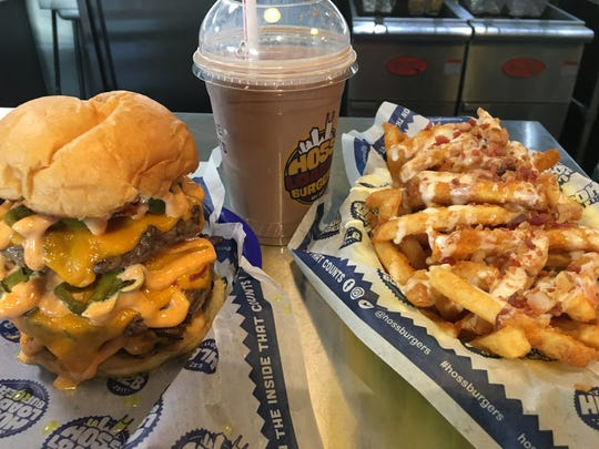 A one-pound cheeseburger, milkshake and loaded queso fries make up the Jaw Dropper Challenge meal offered by Hoss' Loaded Burgers in Nolensville, Tenn.