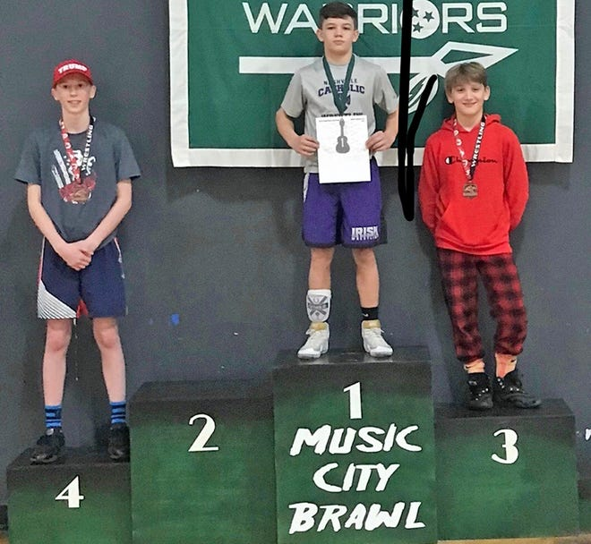 Peyton Mitchell from Jackets Youth Wrestling on the podium again with a 3rd place finish at the Music City Brawl in Franklin on Jan. 4 , 2020.
