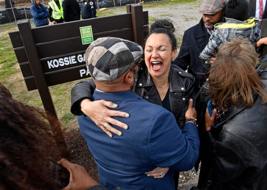 Granddaughter Keisha Gardner-Beard receives hugs after a Naming Ceremony for her grandfather Kossie Gardner Sr. Park which honors one of the city's great African-American entrepreneurs who operated a funeral home a few feet from the sight. in Nashville, Tenn. Thursday, Jan. 9, 2020.