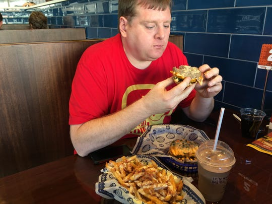 Nashville food blogger Josh Miller started with the burger first in wiping out the Hoss' Loaded Burgers Jaw Dropper Challenge in 17 minutes 48 seconds. Miller credits soda-induced burping for his success.