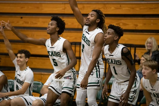 Palmetto Ridge's Malique Dieudonne (5) and Kamonte Grimes (3) and members of the Palmetto Ridge basketball team cheer on their squad as they take on Golden Gate, Wednesday, Jan. 8, 2020, at Palmetto Ridge High School.