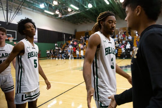 Palmetto Ridge's Malique Dieudonne, left, and Kamonte Grimes shake hands with members of the Golden Gate basketball team shortly after their game, Wednesday, Jan. 8, 2020, at Palmetto Ridge High School.