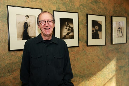 Erik Preminger, son of burlesque queen Gypsy Rose Lee, stands in front of portraits of his mother in his home in Orinda, Calif., on Friday, November 8, 2019.
