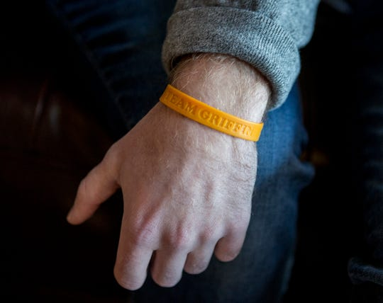 Bailey Hayden wears a 'Team Griffin' band on his wrist in support of his younger brother, Griffin. Bailey recently donated his kidney to his younger brother.